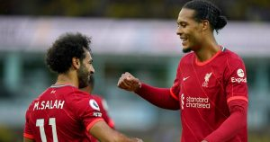 Virgial van Dijk celebrates a Liverpool goal with Mohamed Salah. August 2021.