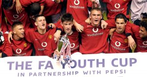 Manchester United players celebrate with the FA Youth Cup trophy