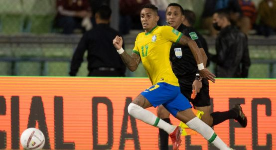 Leeds player Raphinha sprints down the lined during Brazil's game against Venezuela. October 2021.