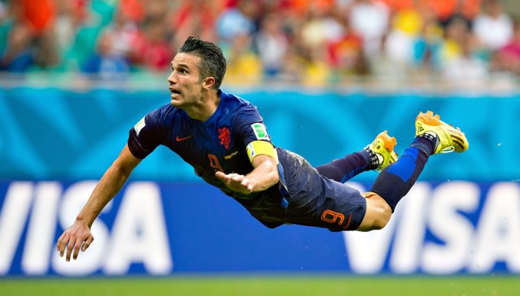 Robin van Persie scores a flying header for the Netherlands v Spain at World Cup 2014.
