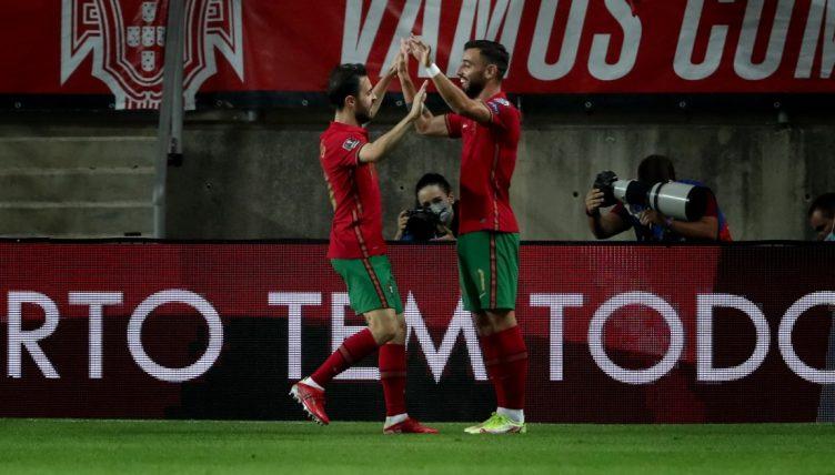 Bruno Fernandes celebrates with Bernardo Silva after scoring for Portugal.