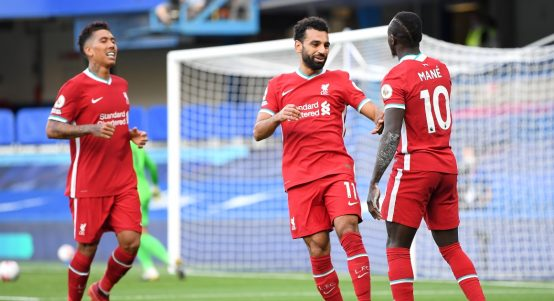 Sadio Mane celebrates with Roberto Firmino and Mohamed Salah after scoring for Liverpool.