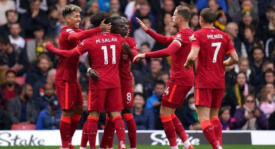 Sadio Mane celebrates with his team-mates after scoring for Liverpool.
