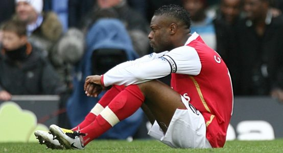 William Gallas sits on the floor after Arsenal lost to Birmingham City.