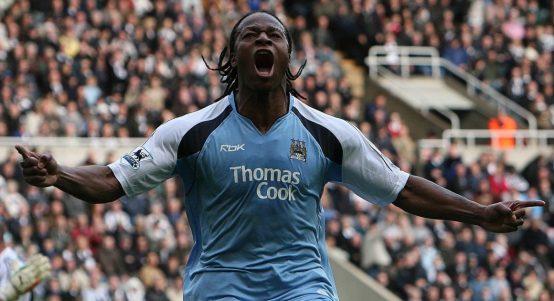 Emile Mpenza celebrates scoring for Manchester City against Newcastle United.