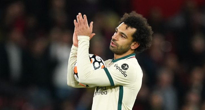 Mohamed Salah with the match ball after becoming the first Premier League player to score a hat-trick at Old Trafford