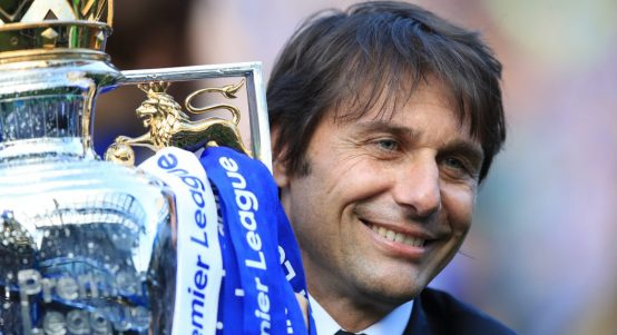 Chelsea manager Antonio Conte holds the Premier League trophy in May 2017.