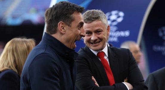 Manchester United manager Ole Gunnar Solskjaer talks to Gary Neville.